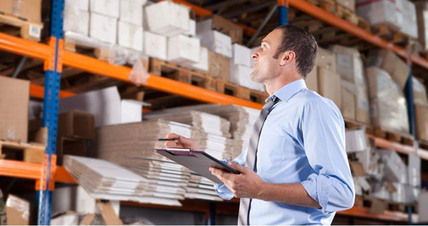 guy in warehouse counting inventory